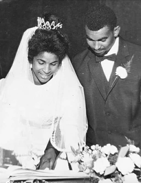 Black and white photograph of Patricia and WInston Johnson on their wedding day.