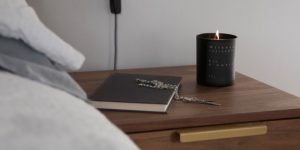 Milkman store candle on side table