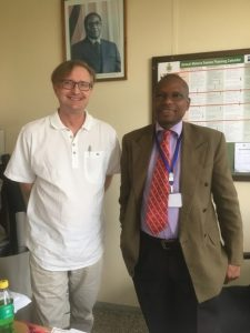 Prof. Peter Case (left) with Dr Mberikunashe, Director of the National Malaria Control Programme, Zimbabwe.