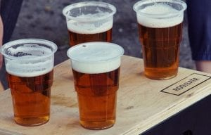 a photo of four pints of beer on a table