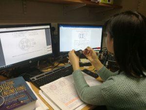 KTP associate Trang at her computer