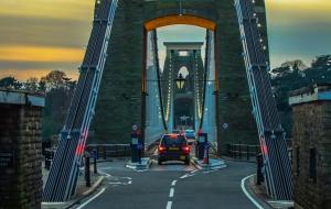 A car going across the Clifton Suspension Bridge