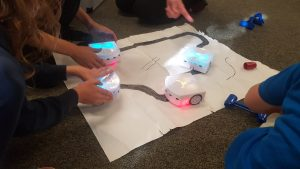 Children playing with small robos