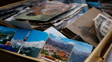 Box of postcards and photographs